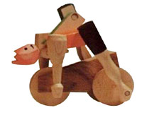 handcrafted_designer_wooden_toys_2405_cyclist_carving_wood_christmas_crafts